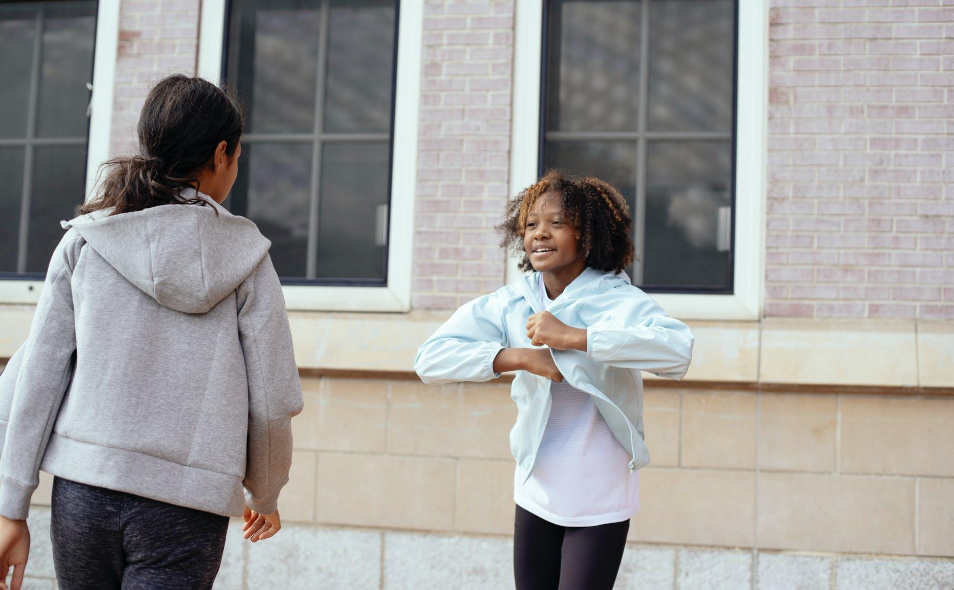 cheerful girls having fun during pe class